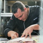 Dragonfly Sushi & Sake Company Chef de Cuisine Jeff Allen preparing a sea bass.