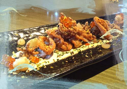 Crispy squid with pickled pearl onion, aji nori furikake and karashi mayo